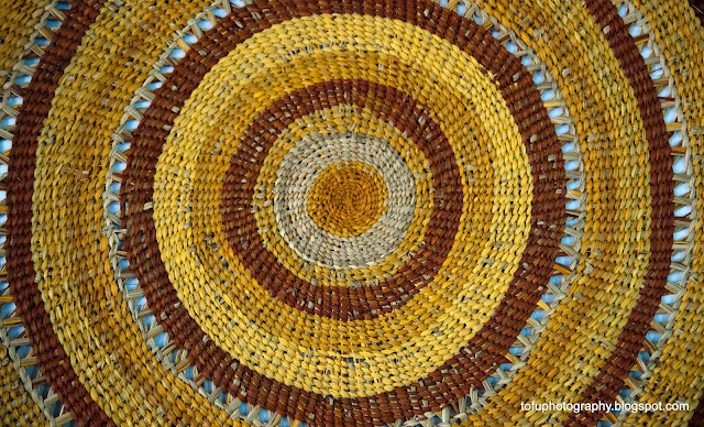 Large coiled mat by Lesley Wininingu Guyula on display at the opening of the Gapuwiyak Arts Centre at the Aboriginal community of Gapuwiyak, Arnhem Land, Northern Territory, Australia on 20 June 2009