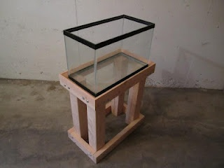 Fish Tank Stand. Much more impressive looking than anything you can buy at a major retailer. Simple dimensional lumber too.