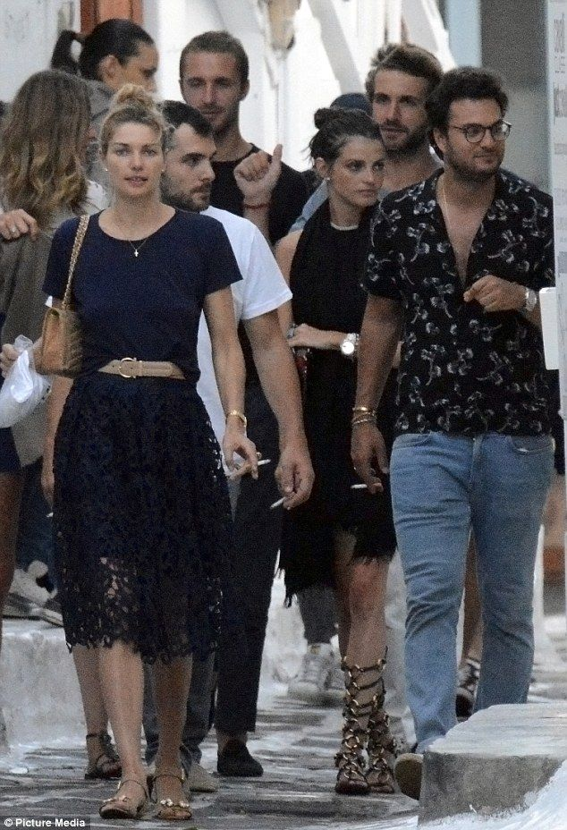 Jessica Hart spotted in Mykonos, an island off Greece, with her billionaire boyfriend Stavros Niarchos III (second from right, in blue) and friends