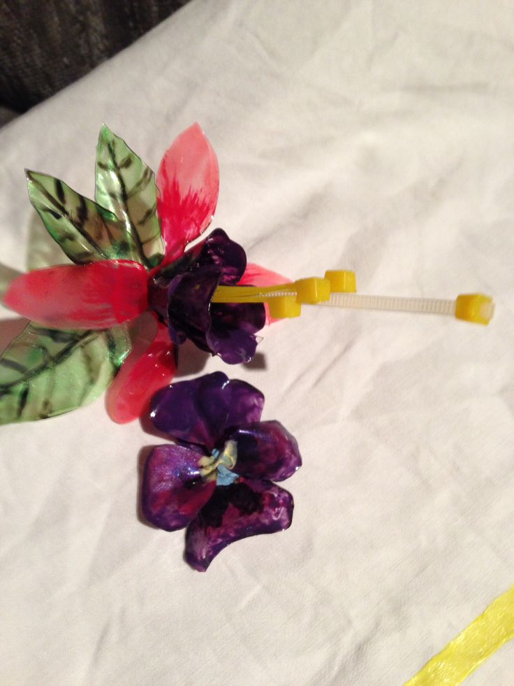 Faux glass flowers I made from recycled plastic and colors with nail polish
