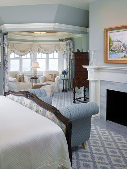 Pretty blue room with attractive patterned carpet & feminine window treatments. Restful, which is what bedrooms are supposed to be!