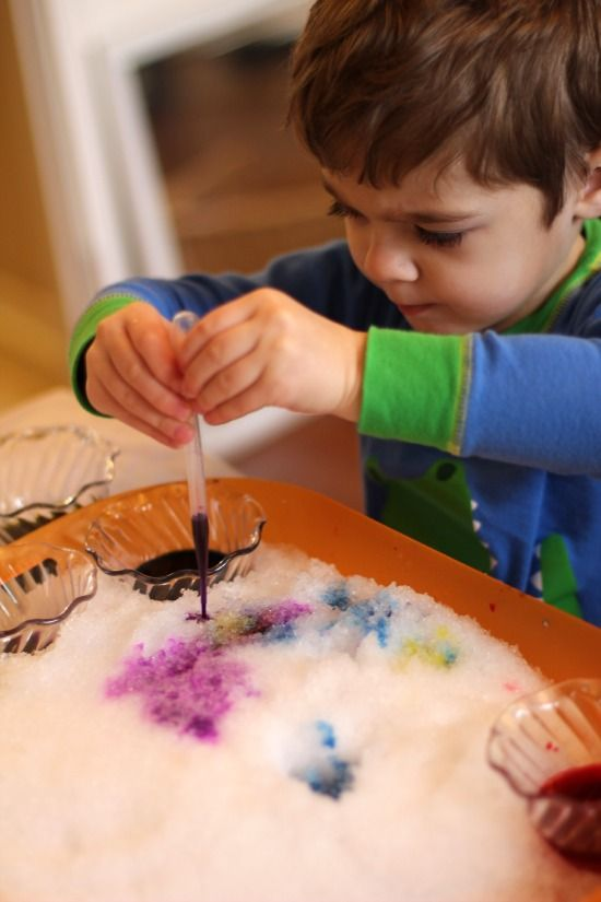 Rainbow Snow Painting. A fun way of exploring color combinations using a winter sensory material.
