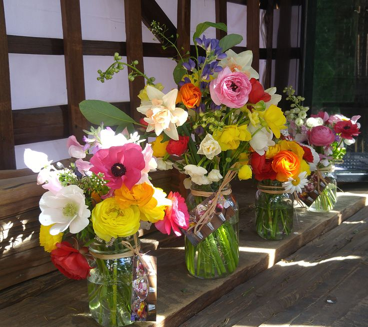 Gorgeous spring colours held in Mason Jar Posies. #masonjarposy #masonjarposies #flowerfarmer #farmstand