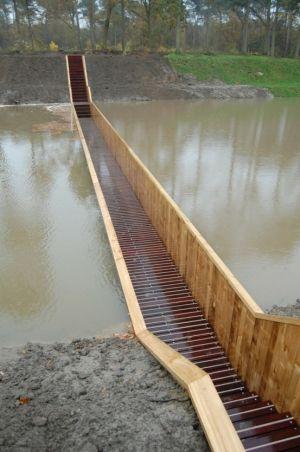 """Sunken """"Moses Bridge"""" in Halsteren, The Netherlands. In accoya wood. By RO(ampersand)AD Architecten."""