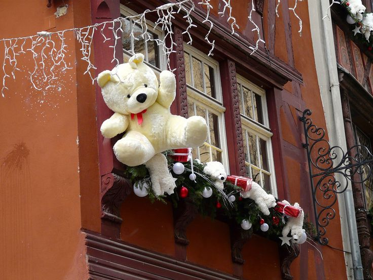 Teddy bears hang from rooftops in Strasbourg, France during the Christmas markets.