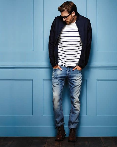 Shop this look on Lookastic: http://lookastic.com/men/looks/white-and-black-crew-neck-t-shirt-navy-bomber-jacket-blue-jeans-dark-brown-boots/7447 — White and Black Horizontal Striped Crew-neck T-shirt — Navy Bomber Jacket — Blue Jeans — Dark Brown Leather Boots