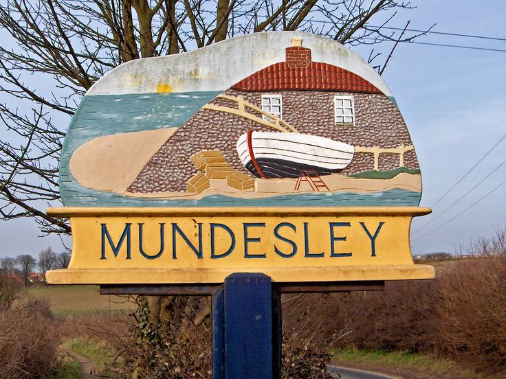 Mundesley village sign on the road into the village