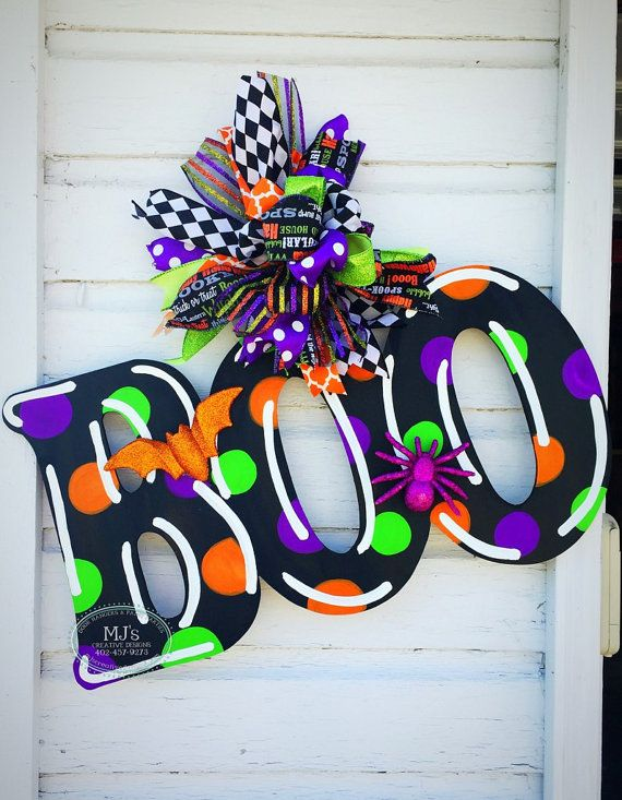 The dots are glow in the dark!! It is hand-cut out of 1/4 inch MDF, painted with acrylic paint, and finished with a protective clear coating that prevents chipping, peeling, or fading. It hangs from sturdy metal wire, and it is accessorized with a multi-layered Colorful bow!  Dimensions- 11 tall X 22 long