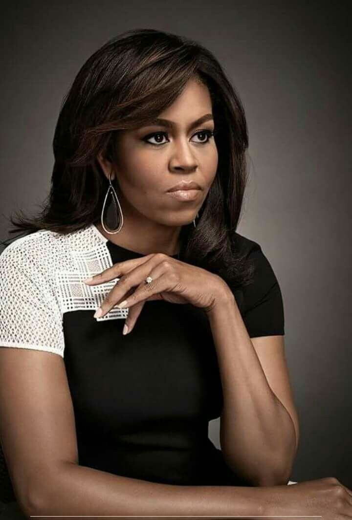 Michelle Obama - very well educated, loving mother and wife, role model. I love her.