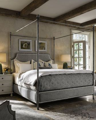 Bed design inspired by English, French, and Swedish antiques. Hardwood frame. Removable metal posts and ball finials. Linen upholstered headboard, footboard, rails accented with spit tacks on contrast