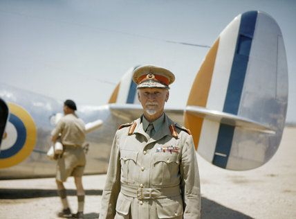 Official photographer -- Field Marshal Jan Smuts, Prime Minister of the Union of South Africa, standing in front of a Lockheed Lodestar aircraft of No. 234 Squadron SAAF. -- High quality art prints, canvases -- Imperial War Museum Prints