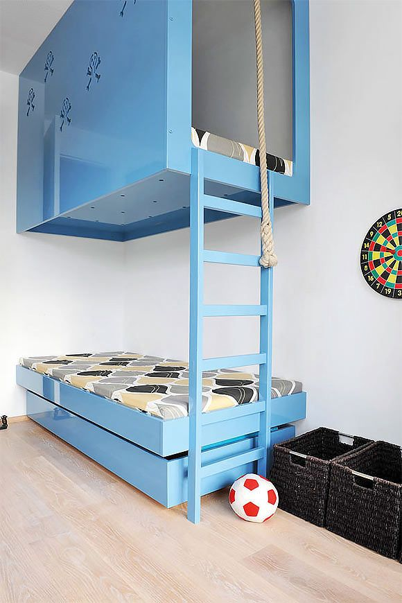 sleek + modern blue bunk beds in a kid's room: