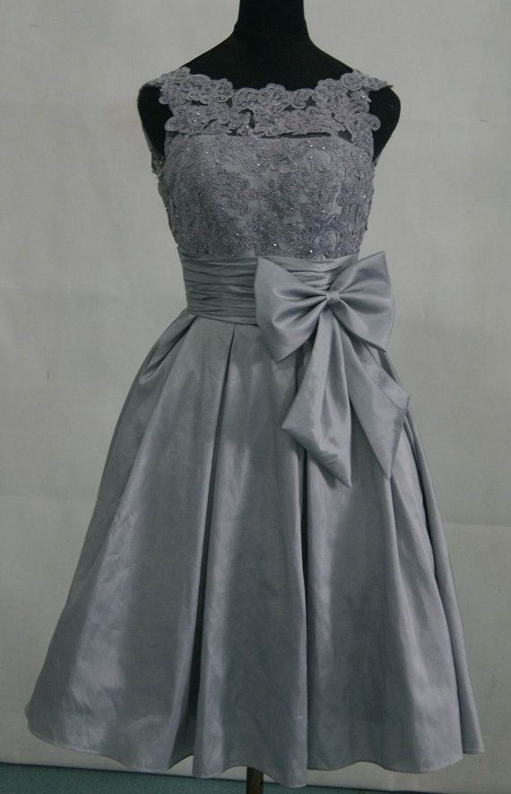 The cut of this dress would work well with a knit shrug or cashmere wrap if you want to keep your maids warm. Taffeta silver grey bridesmaid dress prom dress with by AFairyland, $112.00