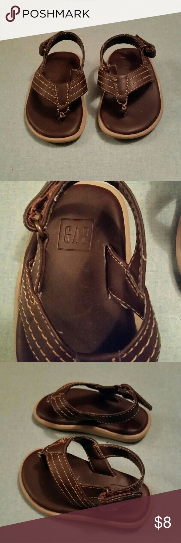 Gap Toddler Brown Leather Flip Flop Very comfortable Gap, Brown leather flip flop sandal for boys Easy to fasten and go with velcro Size from tip of toe to heel is 5 1/2 inches long Size 5/6 T GAP Shoes Sandals & Flip Flops