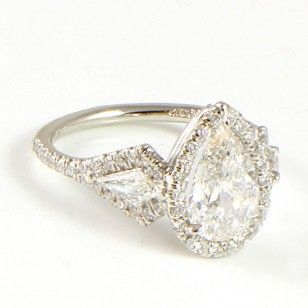 I've never loved a ring more...     PEAR SHAPED DIAMOND RING BY UNEEK  RING IN PLATINUM FEATURING A PEAR SHAPED DIAMOND (1.62CTW F I1) WITH 62 ROUND DIAMONDS (.50CTW) AND TWO KITE DIAMONDS (.34CTW). SIZE 6.