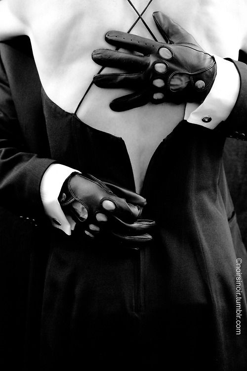 As Daniel held Megan in his strong arms, with one soft leather gloved hand, he firmly settled it on her upper back, the other hand; he moved to her centre and slowly began unzipping her black silk dress. On reaching the middle of her back.... © J.L. Thomas 2013