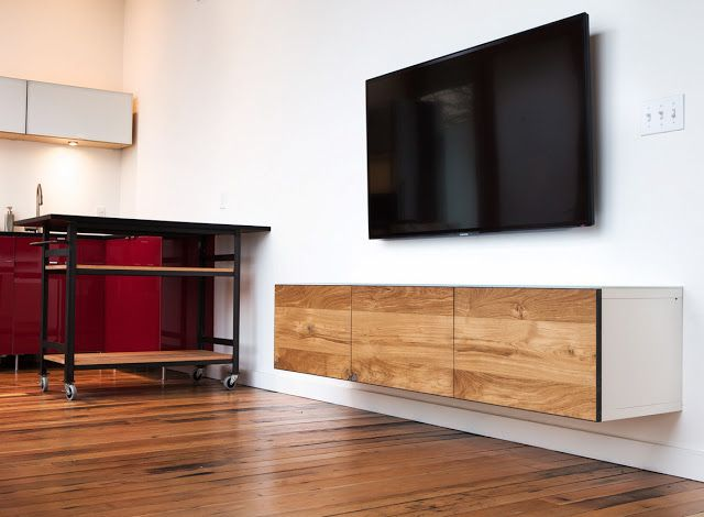 This engineered oak imposed on a white BESTÅ media storage unit will leave you floored