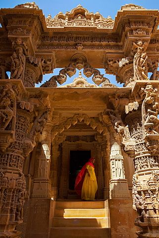 Indian lady in traditional dress in a temple in Jaisalmer, Rajasthan, India, Asia                                                                                                                                                                                 More