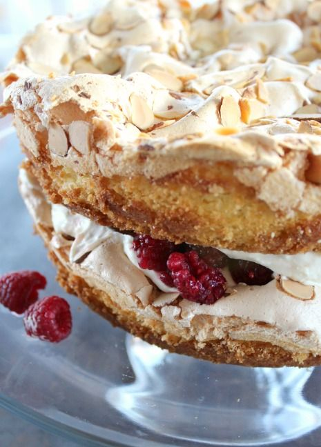 Blitz Torte is a big, gorgeous dessert that is full of fantastic taste and texture. Meringue baked right on top of the perfect yellow cake batter, and assembled with whipped cream, lemon curd and raspberries.