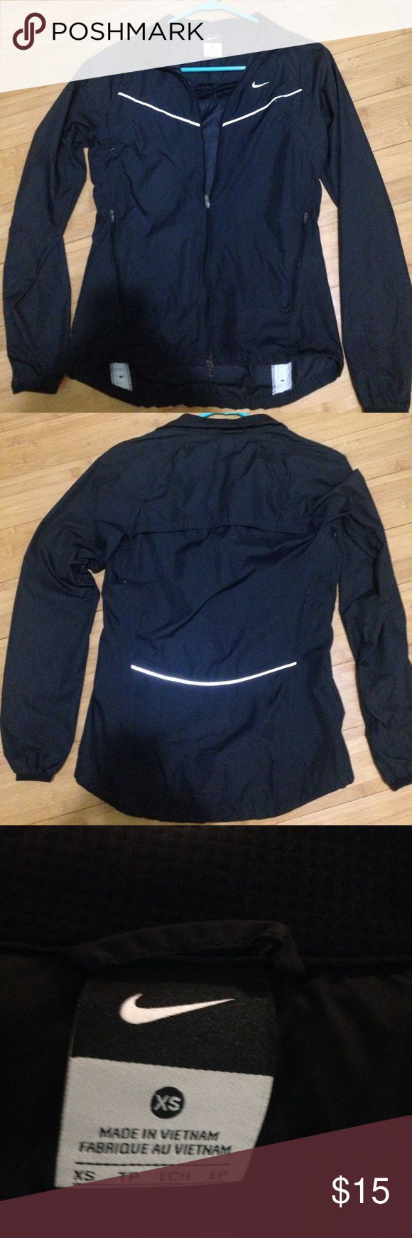 "Ladies Nike Running Jacket Nike Black with 3M reflective trim running jacket. Super light weight, vented in back, pit area, and a few more places. Measures 17"" from pit to pit when laid flat. 24"" length in front and 26"" in back. Sleeves measure 21"" from UNDER armpit to end of sleeve. All zippers work great including the double zipper. Trimmed with 3M for safety when running. SIZE IS XS Nike Jackets & Coats"
