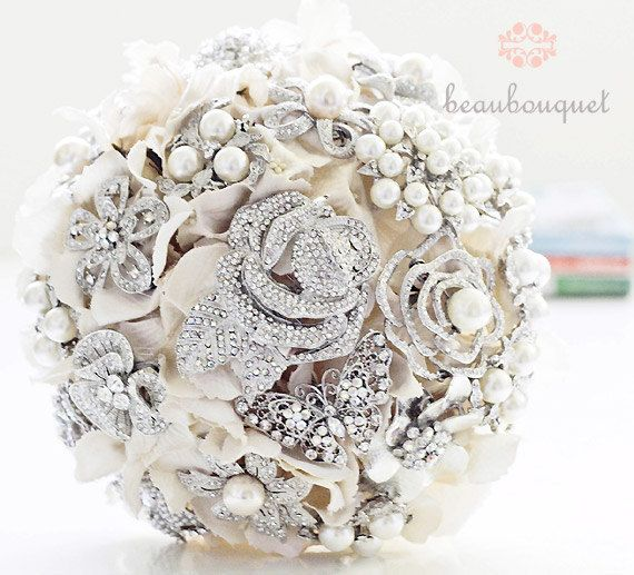 20 Amazing Fake Flower Bouquets... Still debating on wether I want to make the bridesmaids boquets with fake flowers or babys breath.....