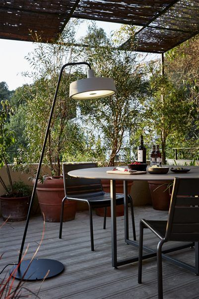 Soho floor lamp for outdoor by Joan Gaspar. Soho is presented as a statement, in recognition of the merits of the lamps traditionally used in markets, taverns and cafeterias.   Whereas before the Soho collection offered diameters of 57 and 112 cm, now it's also available in a smaller size, measuring just 38 cm. This new size is also available as a new outdoor floor lamp. The existing colour range is now joined by two new tones: sand and sky blue.