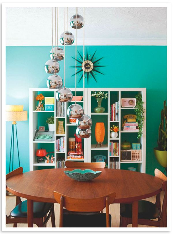 LOVE this room's vintage design. The shelf adornments are fabulous!