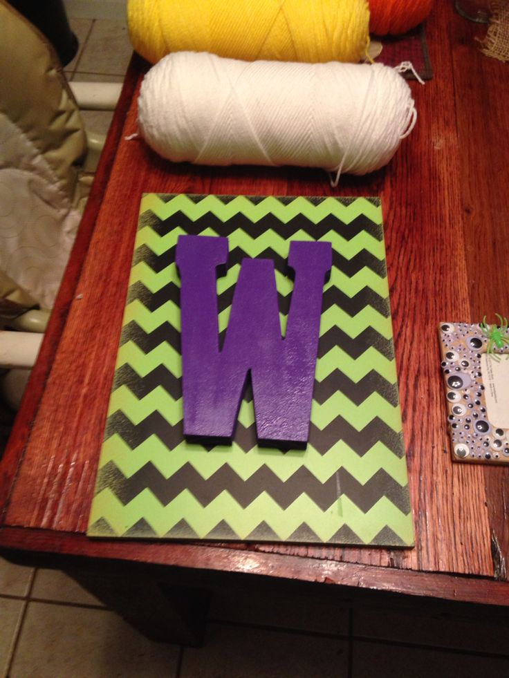 I bought the black and green chevron sign at Hobby Lobby, along with the wooden W. I sprayed the W with purple spray paint and used hot glue to stick to the chevron board!