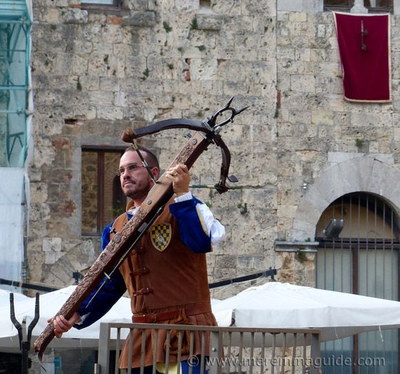 Things to do in Maremma, in a part of Tuscany that will surprise you: medieval crossbow competition in Massa Marittima.