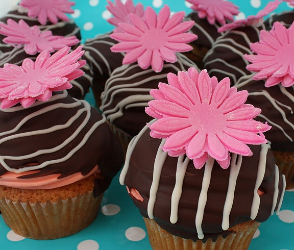 Vanilla cupcakes with a cherry buttercream icing dipped in dark chocolate