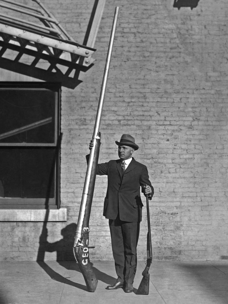 "c. 1920 Chief United States Game Warden George A. Lawyer, with an illegal 10'9"" shotgun weighing 250 pounds, which was used for duck hunting."