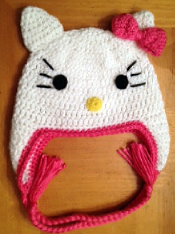 Custom crocheted hot pink Hello Kitty ear flap hat photo prop