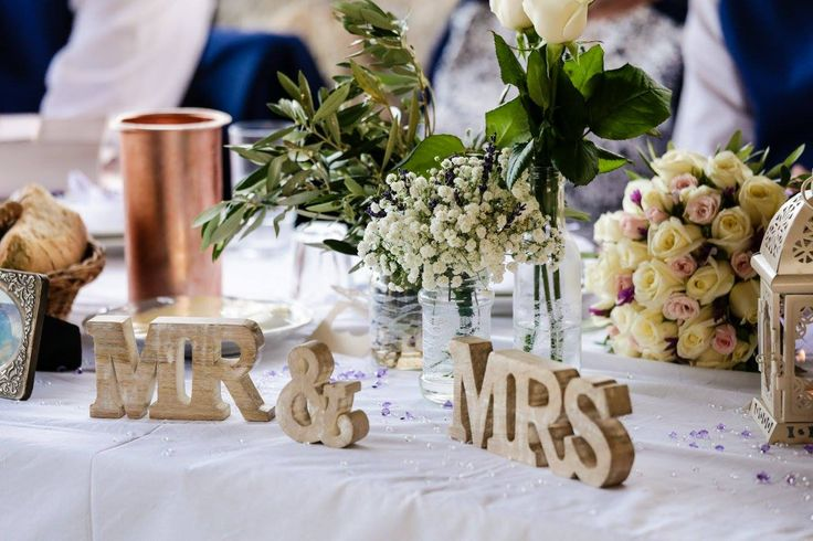 Weddings in Crete - Baby's breath, lavender, rose and olive table decorations complemented by a Mr & Mrs sign and a small white lantern - by Weddings in Crete