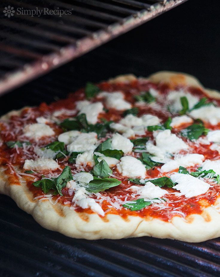 Grilling pizza is the easiest way to make pizza, and you get that great grilled flavor too. NO, the dough does not fall through the grates! See the step-by-step instructions on SimplyRecipes.com