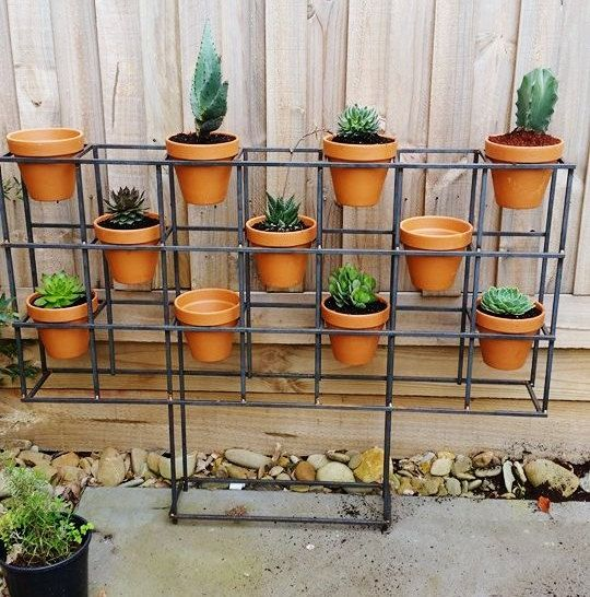Vertical garden. This one was inspired by mid century modern architecture.