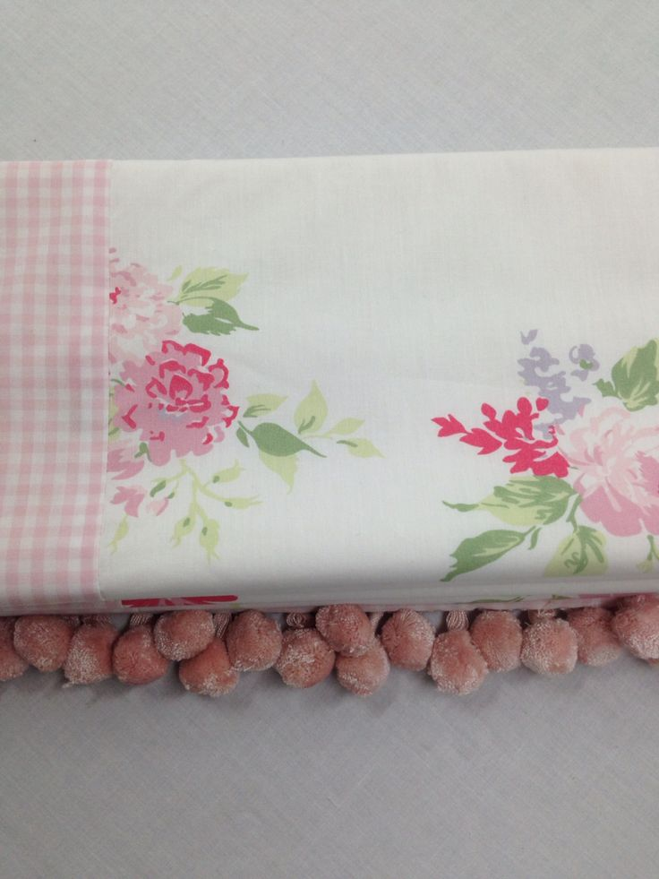 Pretty Roman blind made from the White company fabrics. Random rows of pom-poms added! Photo from our workroom at Midsummer Stitches