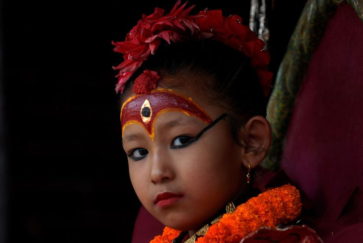 The Kumari, considered a living goddess, attends festivities on the last day of the 2014 Rato Machin... - Fournis par AFP
