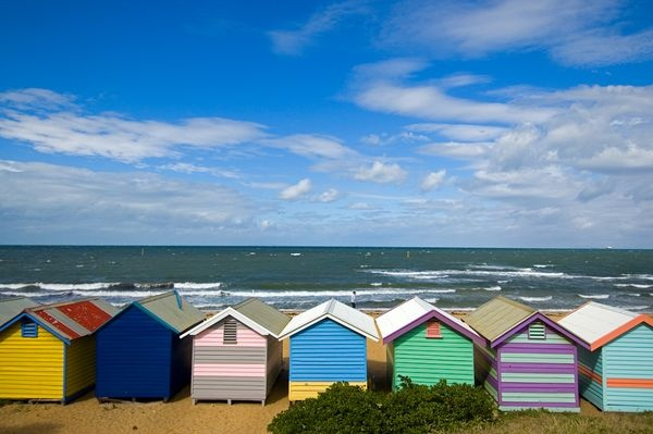 Colorful bath houses line the waterfront on Brighton Beach, Australia