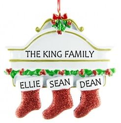 Personalised Christmas Ornament for 3 People - features 3 glittering stockings hanging from a mantel piece, each one personalised with a family members name. WowWee.ie | €13.49