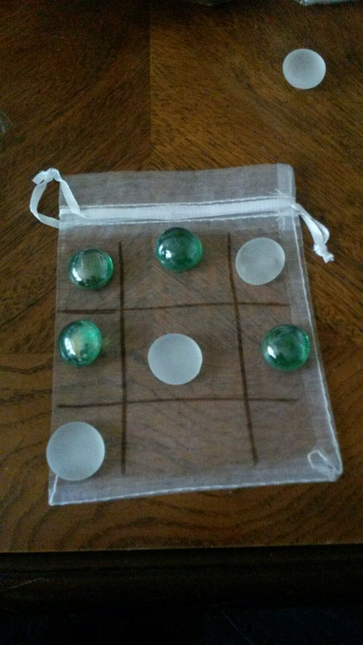 Mini tic tac toe games. Cost about 10 cents to make when you buy in bulk. Great party favors, kids gifts, or for Operation christmas child boxes. All the glass beads go in the bag when done!