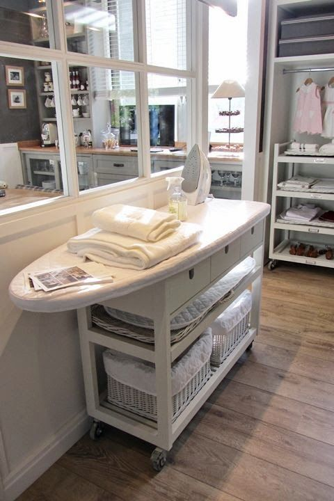Ironing board on top of shelves=no wasted space underneath. Marie-Paule Faure
