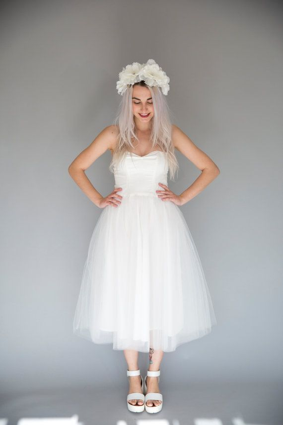 this beautiful tea length ivory tulle dress is a dreamy option for a fun wedding dress