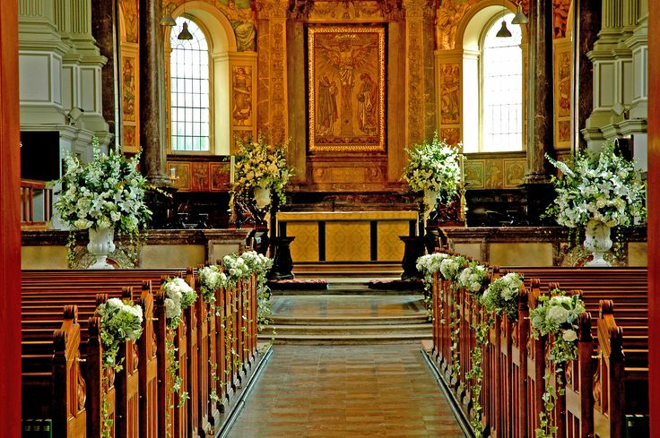 Church wedding flowers. Pew ends and pedestals in white.  Jane Wadham Flowers