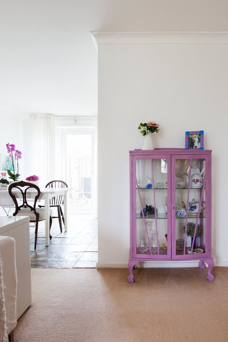 Upcycled 1940s glass display cabinet. Purple paint gives it a modern pop.