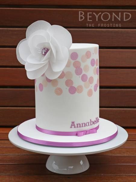 Pink and white double barrel cake with spots and wafer paper flower - by Beyond The Frosting