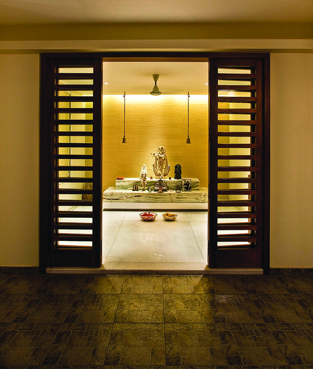 he simple puja room has an air of spirituality. The deities are reverently placed on two onyx blocks.