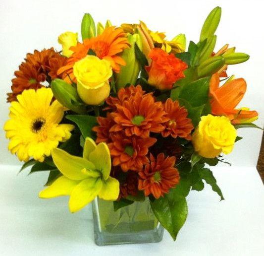 Cubito QDF de flores amarillas y naranjas, perfecto para volver a la rutina con alegría #decoración #beneficiosflores