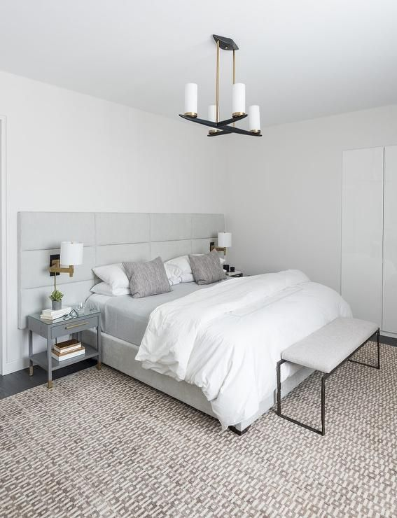 A Long Gray Channel Tufted Headboard On Bed Dressed In White And Bedding Extends Over To Cover Nightstands Illumi