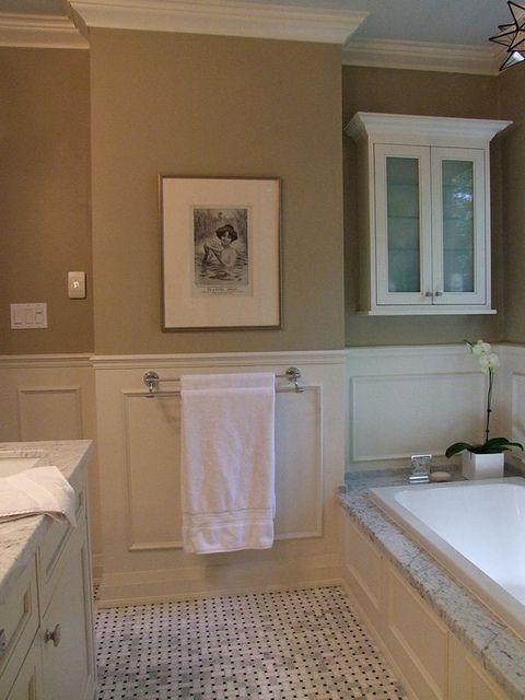 Wainscotting, tan walls, carrara marble, basket weave floor, marble tub deck