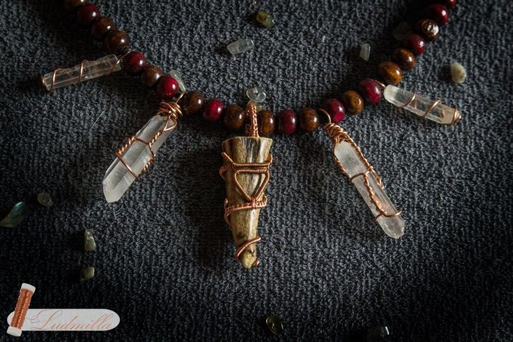 Necklace with quartz crystals and goat horn with symbol of slavic god Veles.